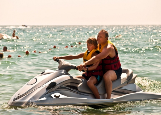 Summer trips to the beach should include personal safety equipment, and quality insurance for vehicles, watercraft and family members.